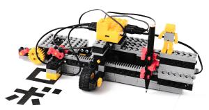 光センサーで文字を読み取り、タッチスイッチやモーターを連動させて制御しながら、全自動でコピーするロボット
